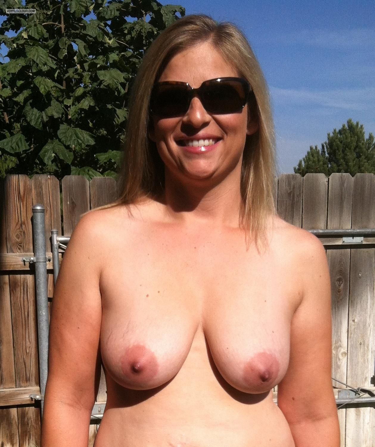 Medium tits topless friends