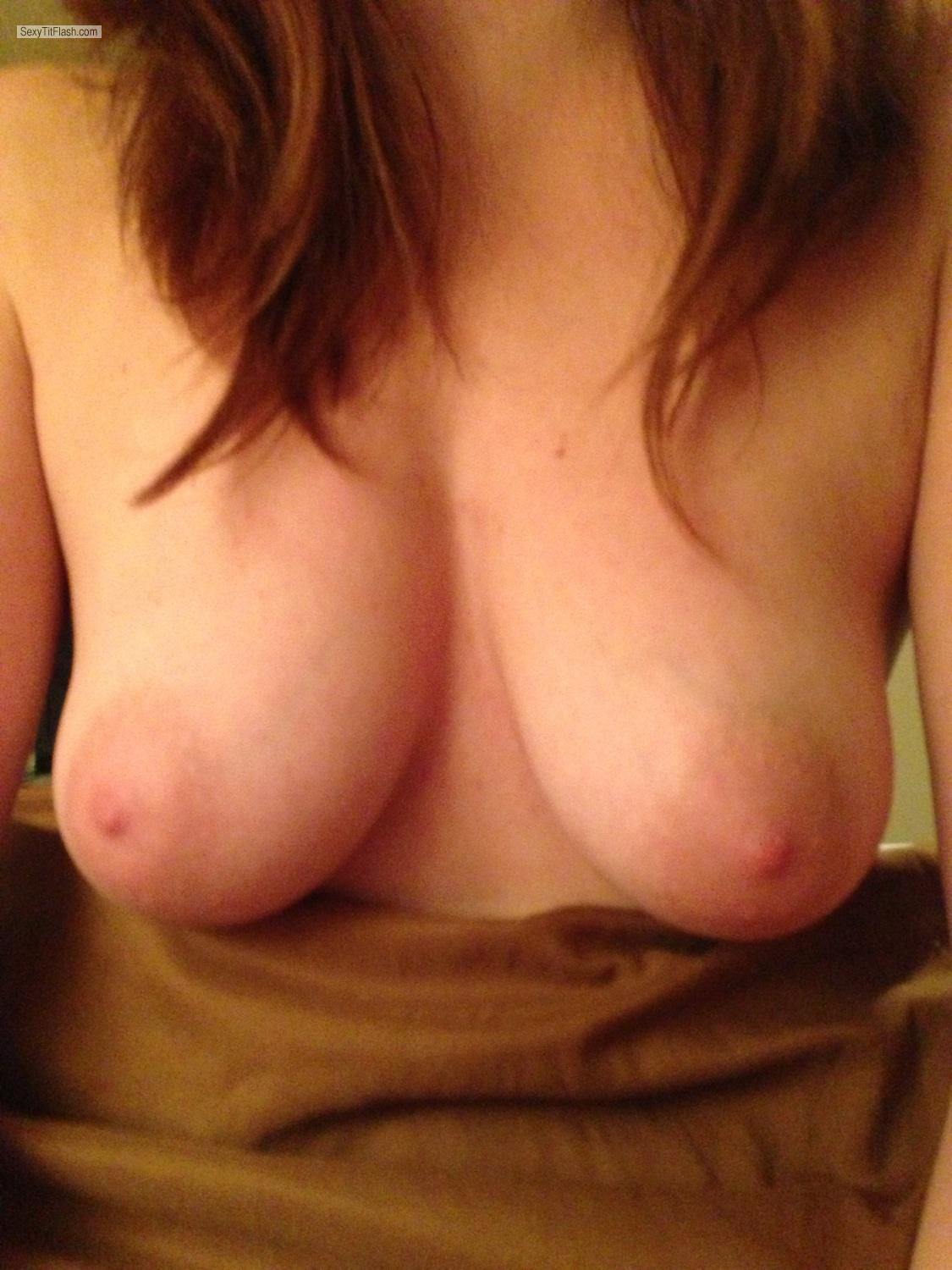 image Girl with medium tits fingering her wet pussy on webcam