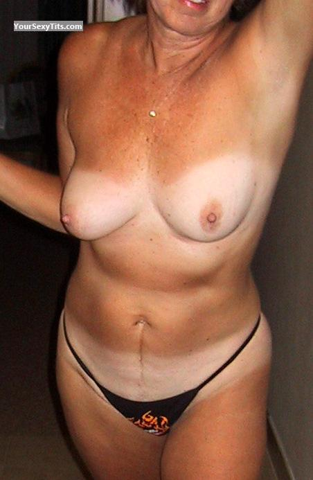 Tit Flash: Medium Tits With Strong Tanlines - DDogg from United States