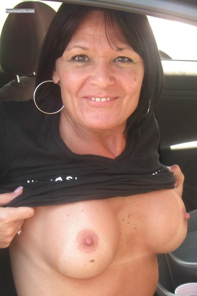 Tit Flash: Medium Tits - Topless Rio from United States