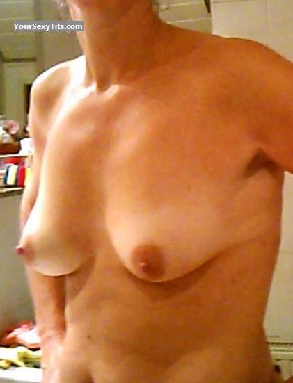 Tit Flash: Medium Tits - Peckerwoman from Germany