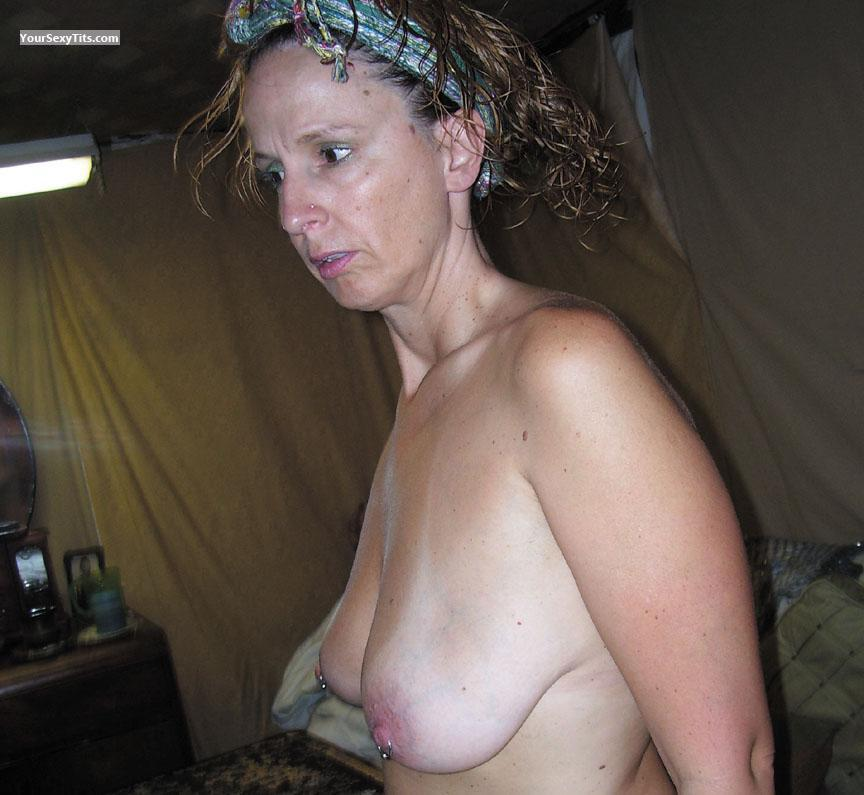 Tit Flash: Medium Tits - Topless Rere from United StatesPierced Nipples