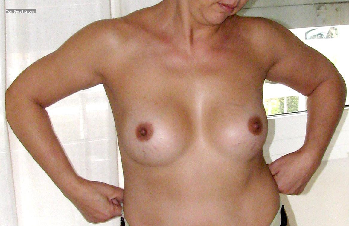 Tit Flash: Medium Tits - MoglieNuda from Italy