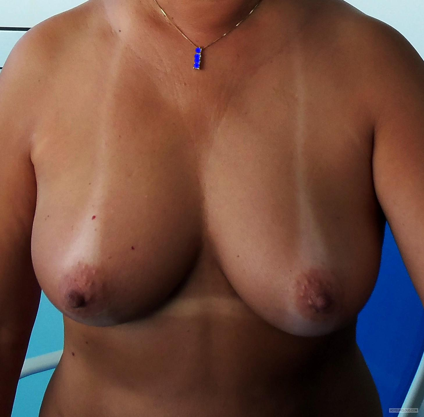 Tit Flash: My Medium Tits With Strong Tanlines - Me from United States