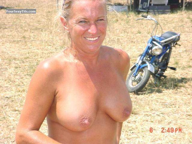 Tit Flash: Medium Tits - Topless Harley from United States