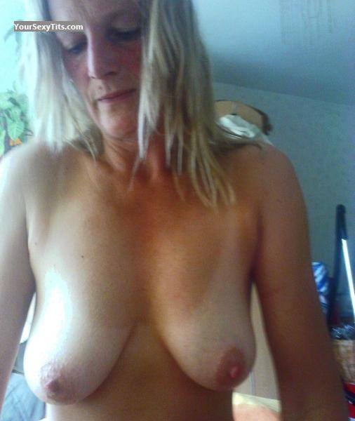 Tit Flash: Medium Tits - Conny from United States