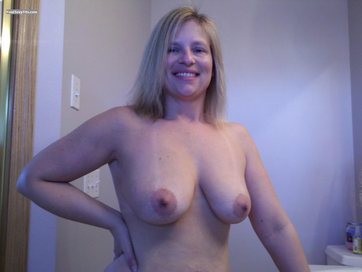 Tit Flash: Medium Tits - Topless American Girl from United States