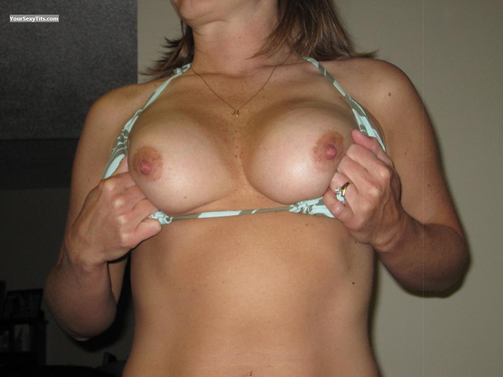 Tit Flash: Wife's Tanlined Medium Tits - Amy from United States
