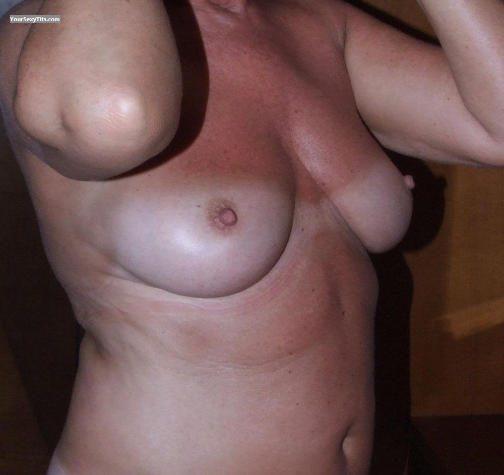 Tit Flash: Wife's Tanlined Medium Tits - Samantha from United Kingdom