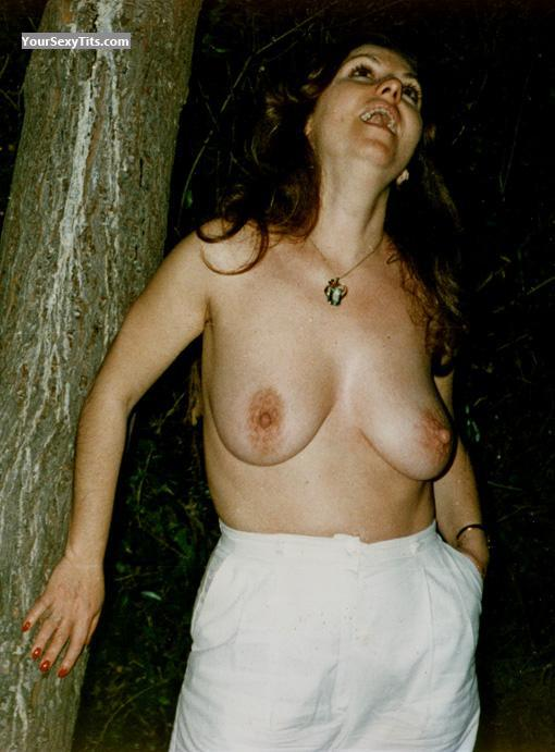 Tit Flash: Medium Tits - Topless Saggie from United States