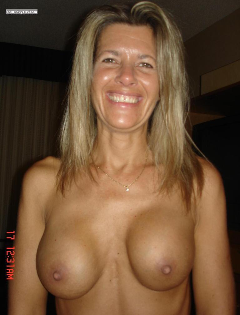 Medium Tits Topless Lady