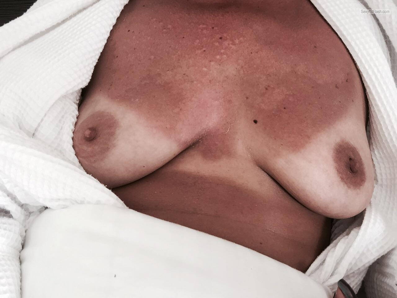 Tit Flash: My Medium Tits With Strong Tanlines - E V from United States