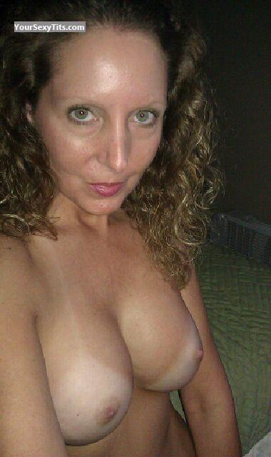 Tit Flash: Girlfriend's Tanlined Medium Tits (Selfie) - Topless Summer from United States