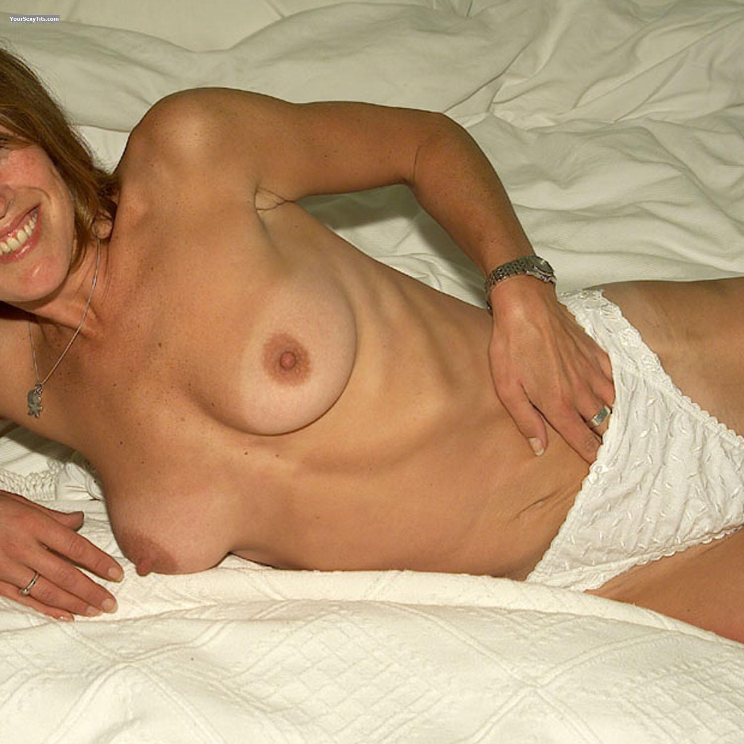 Tit Flash: Tanlined Medium Tits - Girl Next Door from United Kingdom