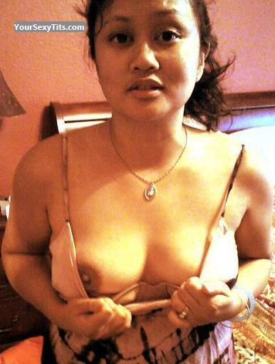 Tit Flash: Medium Tits - Topless Che from United States