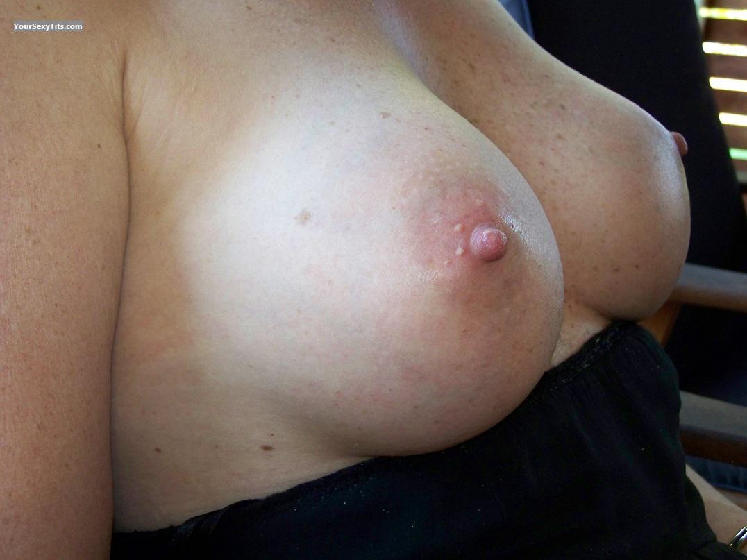 Medium sized naked boobs