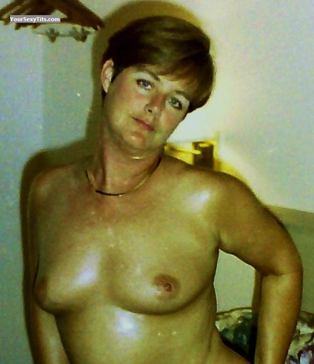 Tit Flash: Medium Tits - Topless Ginger from United States