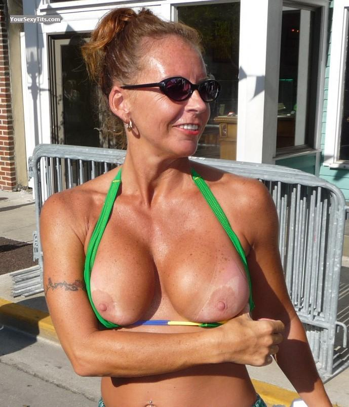 Tit Flash: Medium Tits - Topless Street Flash from United States