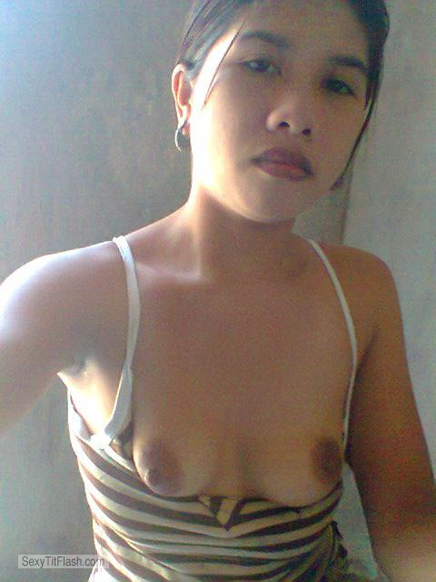 Tit Flash: Room Mate's Small Tits - Topless Eka from Indonesia