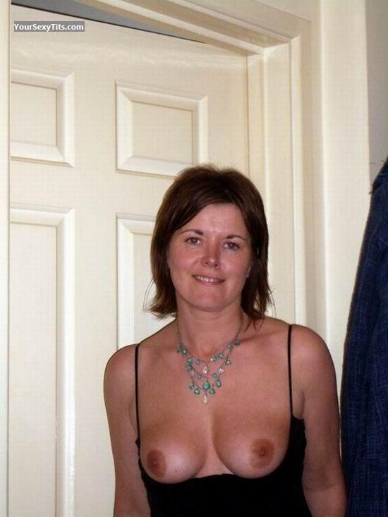 Tit Flash: Medium Tits - Topless Nellie from United Kingdom