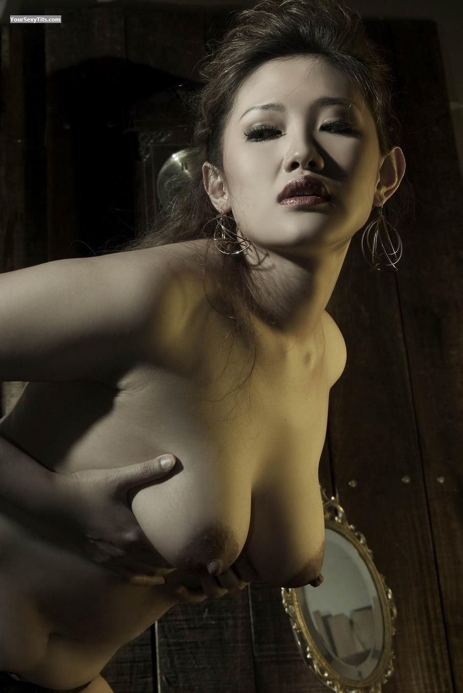 Tit Flash: Medium Tits - Topless Lina Wang from Indonesia