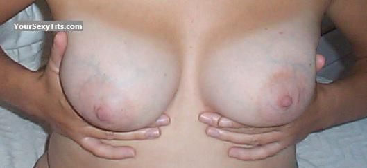 Tit Flash: Wife's Tanlined Medium Tits - Milk Full Squeeze from United States