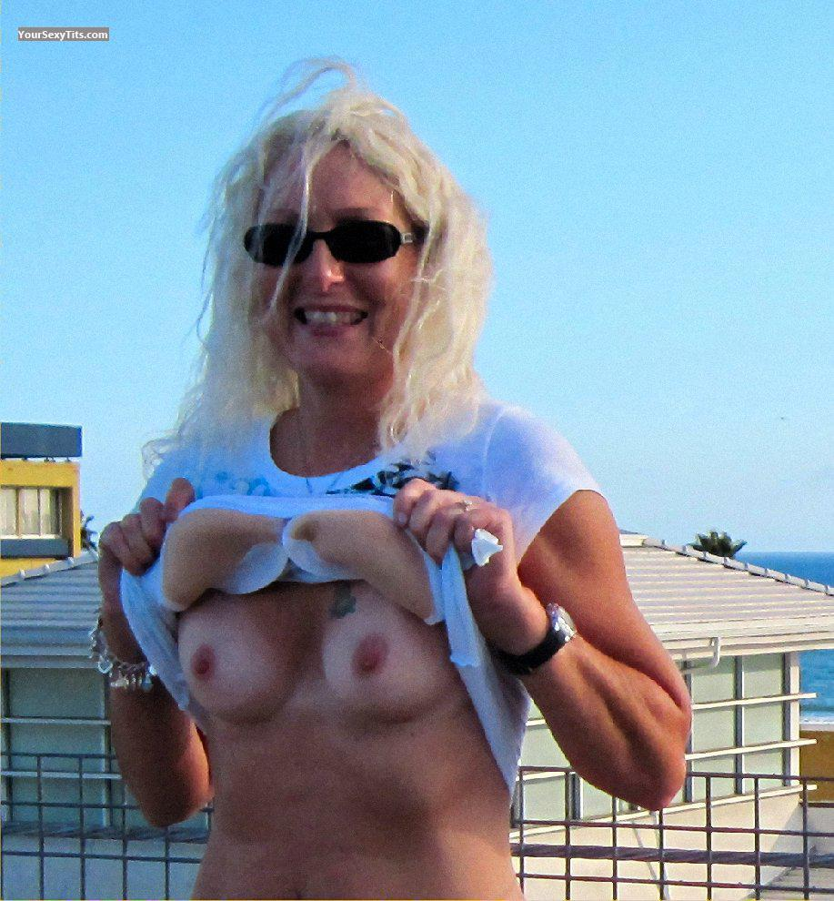 Tit Flash: Wife's Tanlined Small Tits - Topless Pretty Woman from United States
