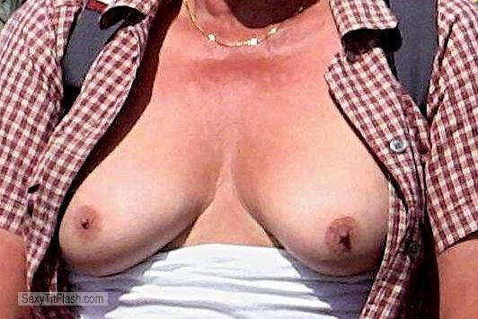 Tit Flash: Wife's Small Tits - Strandfee from Germany
